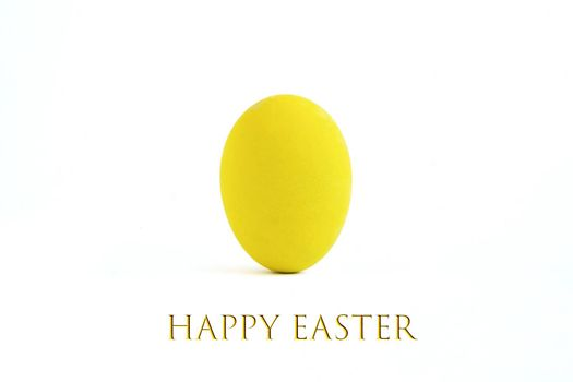 An easter egg painted with yellow color, isolated on white background