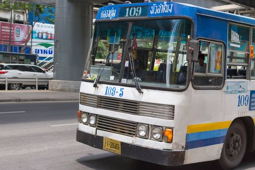 Bangkok, Thailand - May 3, 2016 : Unidentified people travel by bus in Bangkok. Buses are one of the most important public transport system in Bangkok.