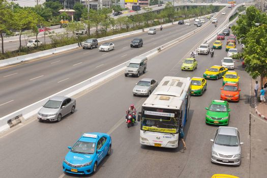 Bangkok, Thailand - May 14, 2016 : Unidentified people travel by bus in Bangkok. Buses are one of the most important public transport system in Bangkok.