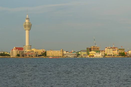 Samut Prakan, Thailand - March 25, 2017: Riverfront view of Samut Prakan city hall with new observation tower and boat pier. Samut Prakan is at the mouth of the Chao Phraya River on Gulf of Thailand.
