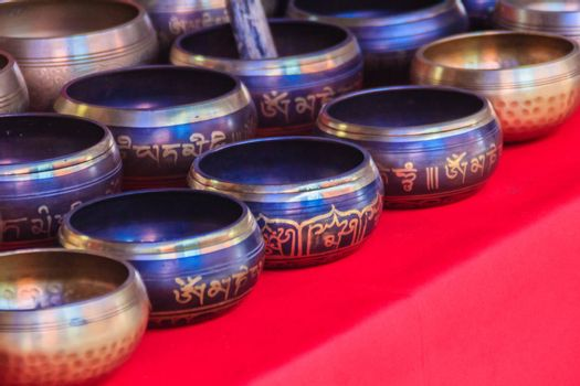 Tibetan singing bowls for sale at the antique market. Singing bowls also known as rin gongs, Himalayan bowls or suzu gongs are used worldwide for meditation, music, relaxation, and personal well-being