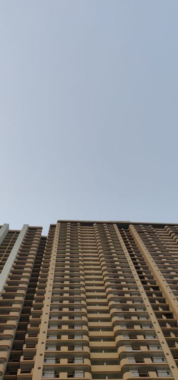 A high rise apartment building reaching for the sky