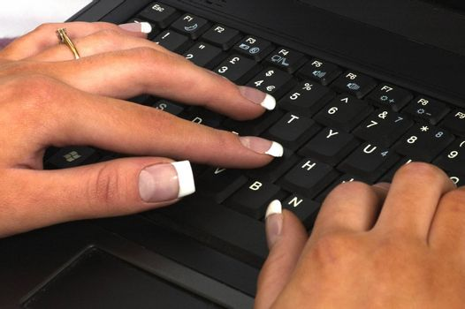 Laptop and feemale hands