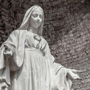 White stone statue of saint Mary