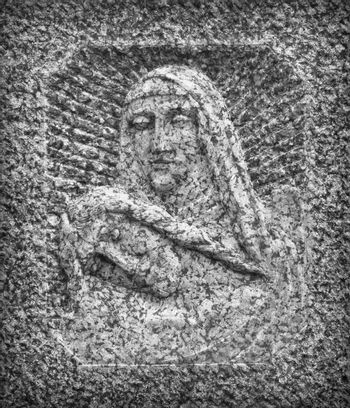 Bas-relief in stone representing The Pity of Michelangelo. Faces of Holy Mary mother and Jesus Christ after the Crucifixion.