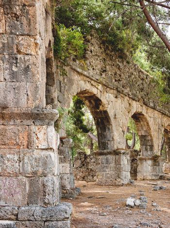 Ruins of aqueduct of ancient Phaselis city. Famous architectural landmark, Kemer district, Antalya province. Turkey.