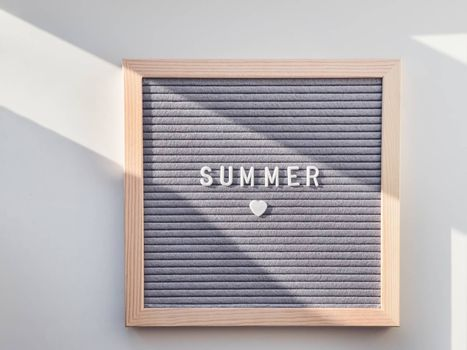 Top view on letter board with word Summer and heart. Flat lay concept symbol of love and romance.