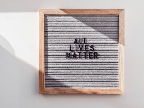 Top view on letter board with words All lives matter. Flat lay concept with actual statement. Social issue. Race problem in society.