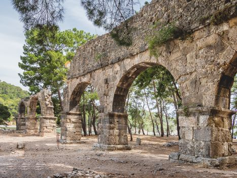 Ruins of large bath in ancient Phaselis city. Famous architectural landmark, Kemer district, Antalya province. Turkey.