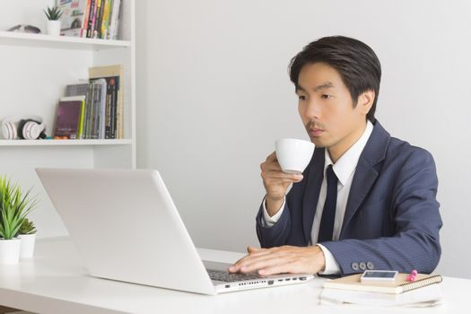 Asian Financial Advisor or Asian Consulting Businessman Drinking Coffee in Break Time. Asian Businessman in relax time