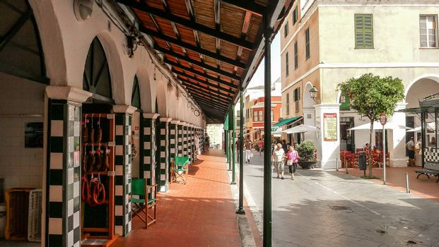 Menorca, Spain - june 28 - 2012 - View from the street of the city market of Ciutadella de Menorca, with arches and walls decorated with checkered majolica features
