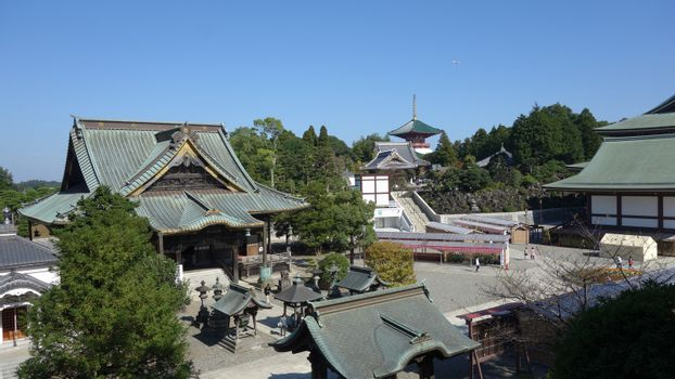 Naritasan Shinshoji Temple- Pavilion - Pagoda- Narita, Chiba, Japan.2017-10-25.  Top view - Tourist go to the of Naritasan Temple in the morning