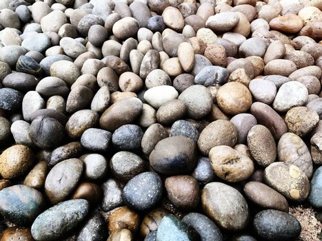 Nature background from sea pebbles. Pebble stones at the sea, Colorful Pebble Stones. Beach stones background.