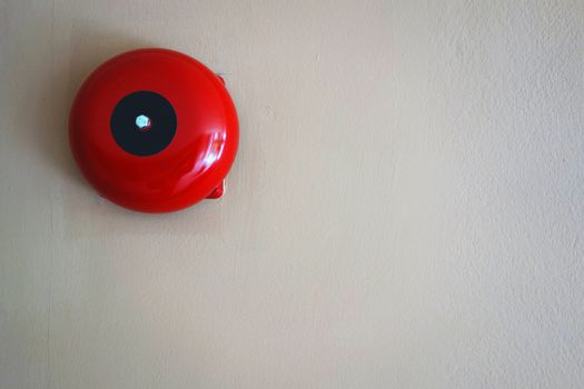 Red round call point for fire alarm. Red wall mounted Fire Alarm Bell in the Department store building.