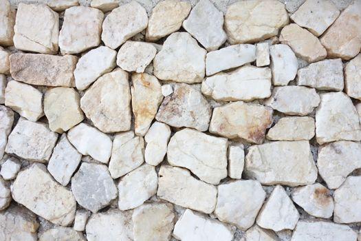 Seamless rock texture background closeup. stone wall.pattern of decorative white slate stone wall surface