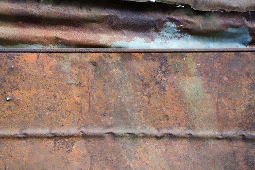 Dark worn rusty metal texture background.
