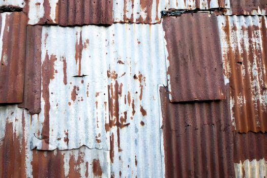 Old rusty zinc plat wall, Zinc wall ,rusty Zinc grunge background. process in vintage style