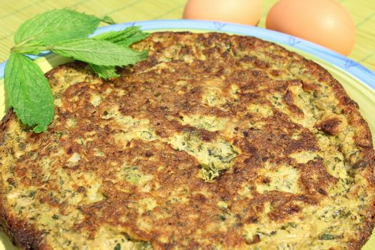 Frittata with mint leaves and herbs