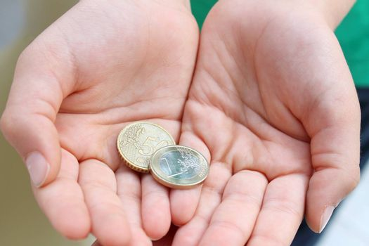 Child's hands  with money