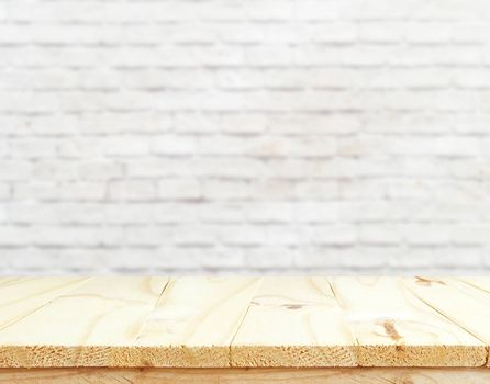 wooden table,mock up interior decoration design for advertising decoration with wooden table texture ready for your product display montage over blured white brick wall