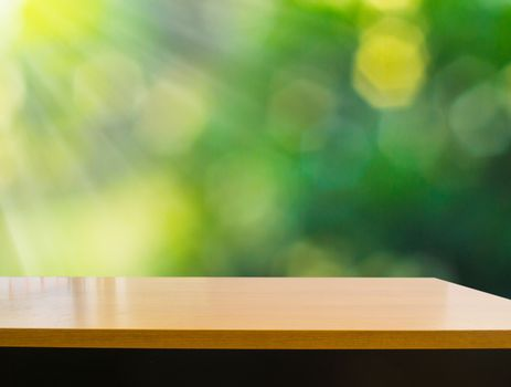 Empty wooden deck table with foliage bokeh background, Ready for product display present