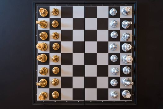 top view of chess pieces on a chessboard, business strategy concept
