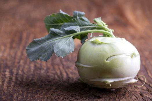 single raw cabbage turnip on wood