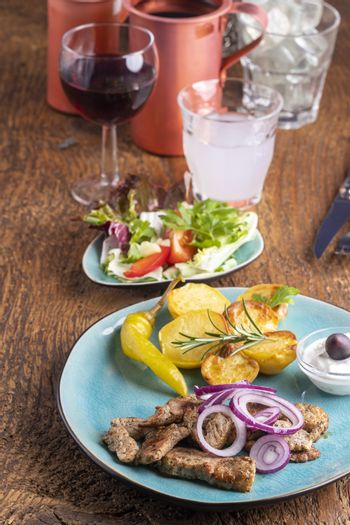 greek gyros with salad and ouzo