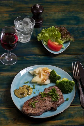 steak with broccoli on a plate