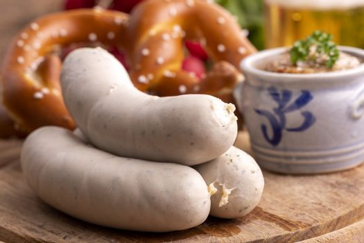 three bavarian white sausages with mustard
