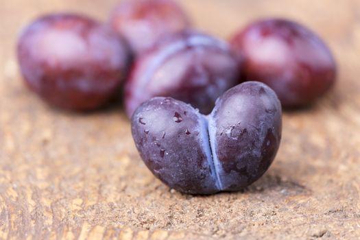 heart shape plum on dark wood