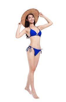 Young beautiful woman wearing swimsuit bikini , isolated on white