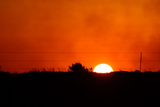 Cloudy orange sunset over a countryside horizon, Pretoria, South Africa