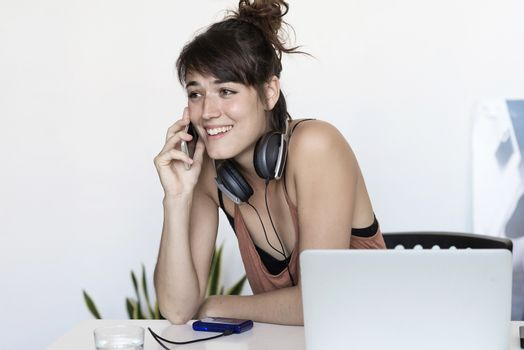 Freelancer working on the phone and laptop