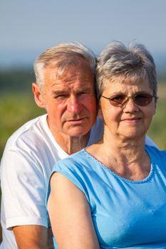 Happy elderly seniors couple in outdoors