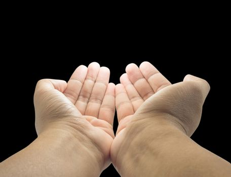 open empty pray hands isolated on the black background