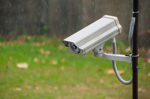 CCTV security camera in raining at the garden