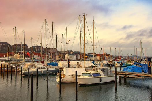 Harbor with sailboats and yachts moored in the port. Sea landscape.
