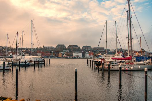 FLENSBURG, GERMANY. JANUARY 26, 2020. Yachts at the pier People walking on the embankment