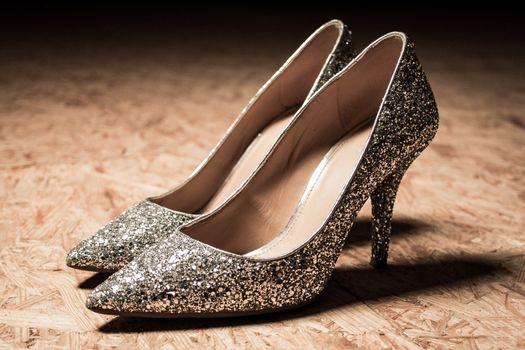glitter high heels woman shoes shiny fashion. High quality photo