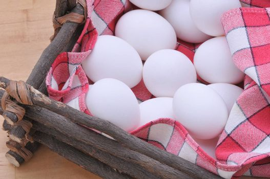 Eggs in a rustic basket with checkered napkin