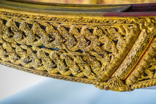 Beautiful traditional Thai style craving patterned of Suphannahong royal barge. Swan head craved pattern in thai royal barge.