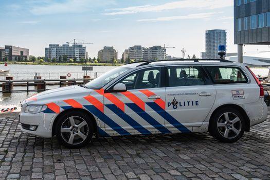 Police stationwagon parked at IJDock, Amsterdam Netherlands.