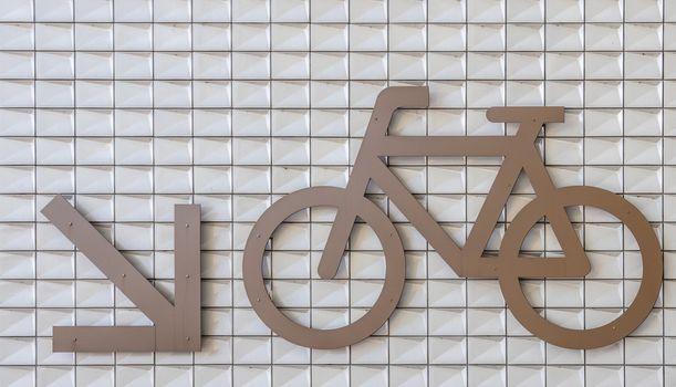 Bike parking sign with direction marker, Amsterdam Netherlands.