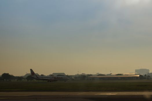 Thai LionAir Airplane is taxiing on the runway before taking off at Don Muang Airport, the old international airport that is now being used by domestic carriers.