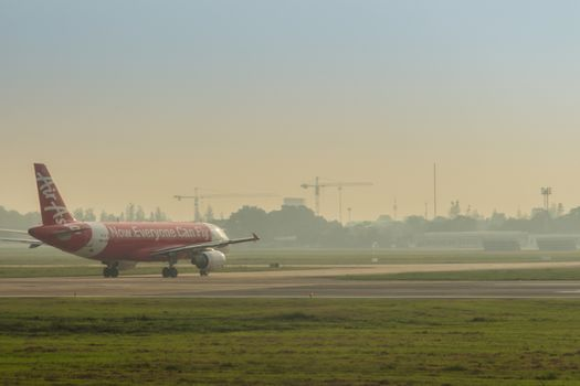 Airbus A320 of Thai AirAsia is taxiing on the runway before taking off. AirAsia company is the largest low cost airlines in Asia.