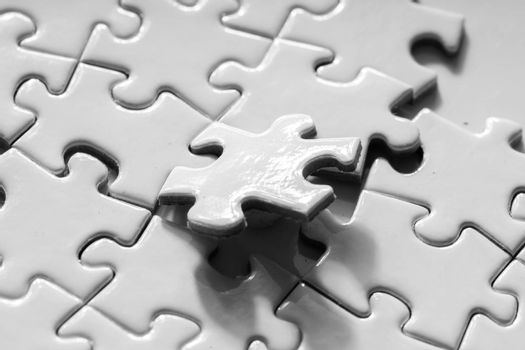 Close up of white jigsaw for business concept