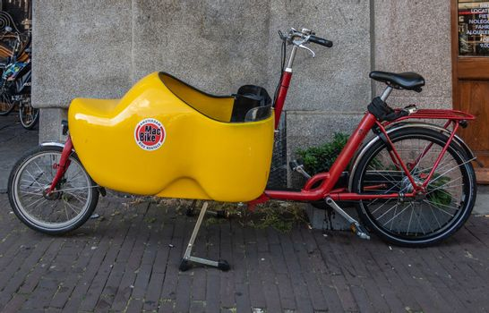 Parked Bakfiets or front-trunk bike in Amsterdam Netherlands.