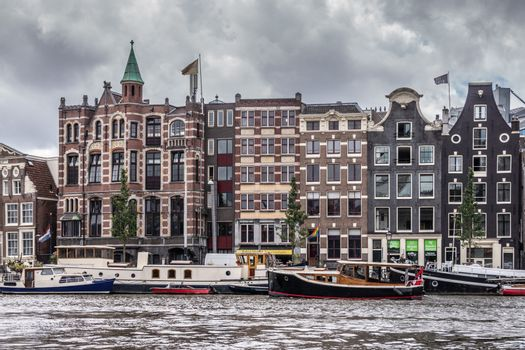 Facades along Amstel River downtown Amsterdam, the Netherlands.