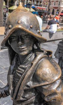 Boy statue on Rembrandtplein, Amsterdam, the Netherlands